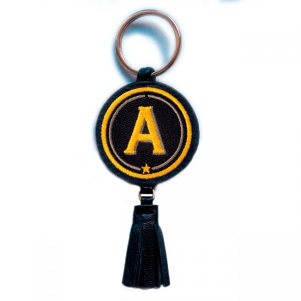 Schlüsselanhänger ABC · gelb/beige · mit Tassel