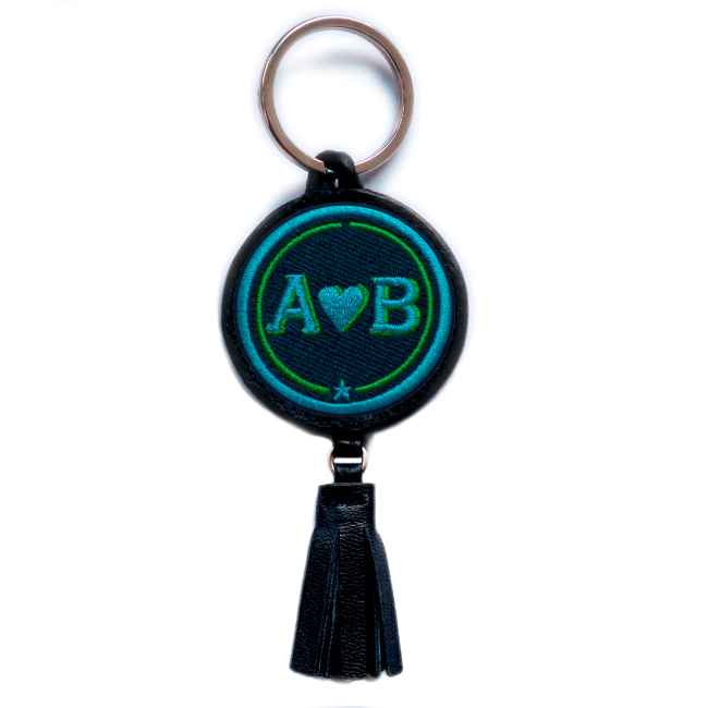 Key ring LOVE turquoise/green with tassel · customizable