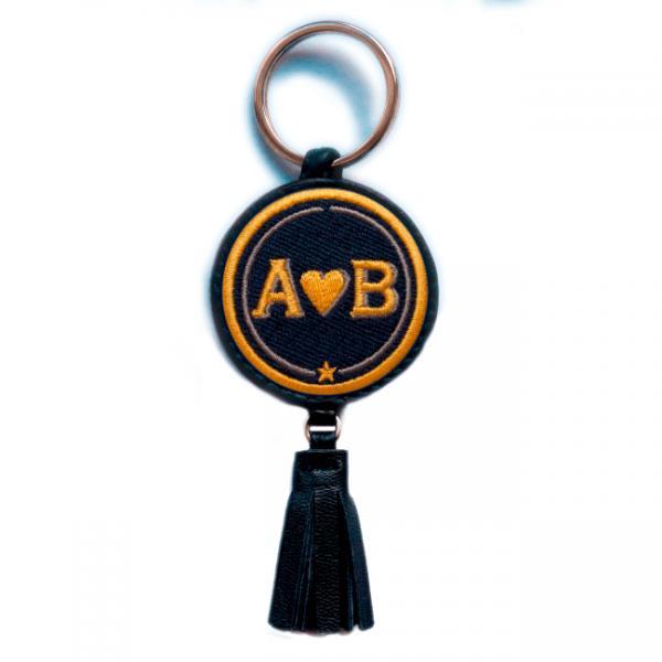 Schlüsselanhänger Love · gelb/beige · mit Tassel · personalisierbar