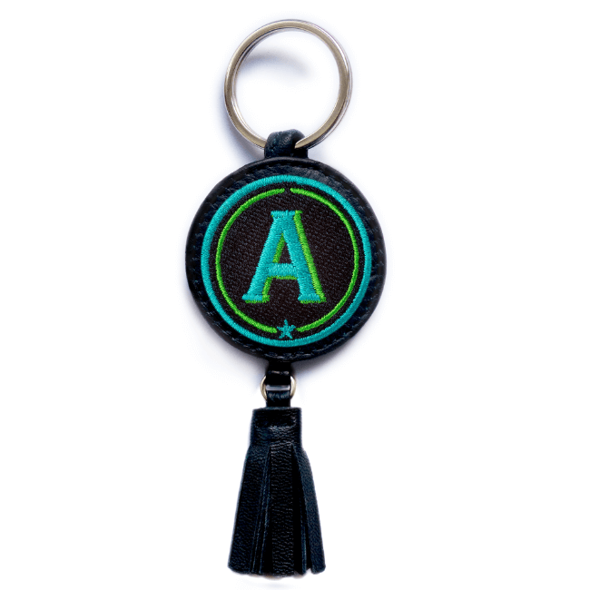 Key ring ABC · turquoise/green · with tassel